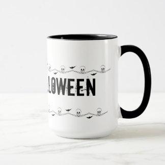 Hands holding skulls mug