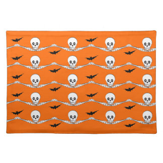 Hands holding skulls placemats
