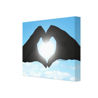 Hands in Heart Shape Silhouette on Blue Sky Canvas Print