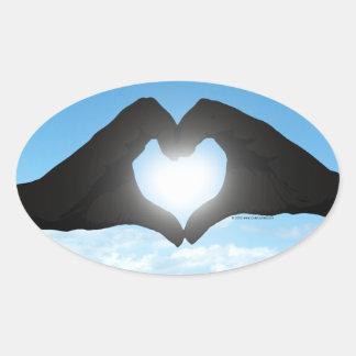 Hands in Heart Shape Silhouette on Blue Sky Oval Sticker
