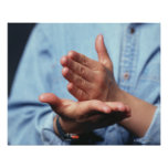 Hands making gesture: one hand held straight on posters