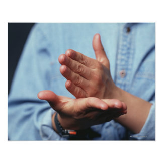 Hands making gesture: one hand held straight on poster