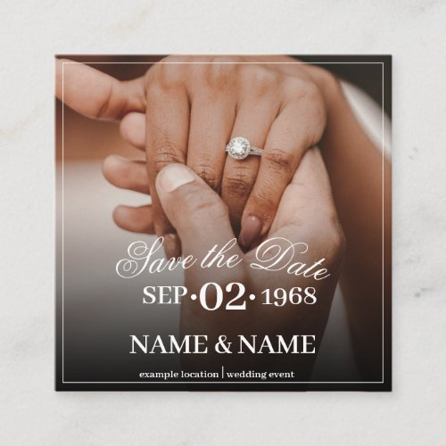 Hands of a colored wedding couple with ring enclosure card