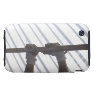 Hands of a male gymnast gripping a horizontal tough iPhone 3 case
