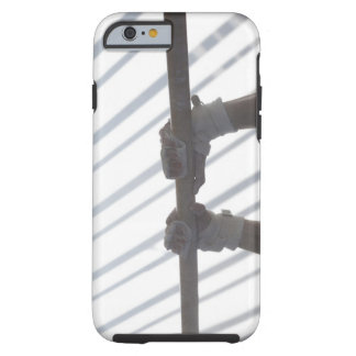 Hands of a male gymnast gripping a horizontal tough iPhone 6 case