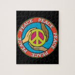 """Hands of Peace Jigsaw Puzzle<br><div class=""""desc"""">Hands from people of different races help hold a peace symbol with the word peace around them.</div>"""