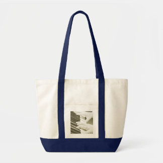 hands playing piano bag