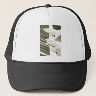 hands playing the piano photograph sepia trucker hat