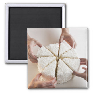 Hands pulling slices from cake 2 inch square magnet