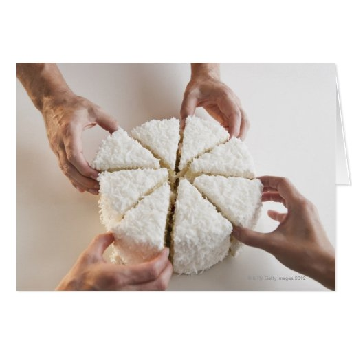 Hands pulling slices from cake greeting card