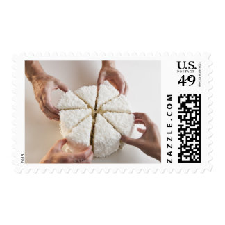 Hands pulling slices from cake postage stamp