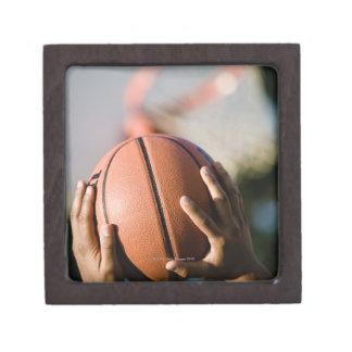Hands shooting basketball outdoors premium trinket boxes