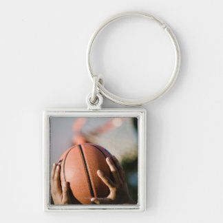 Hands shooting basketball outdoors Silver-Colored square keychain