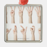 Hands showing Chinese way of counting Christmas Ornament