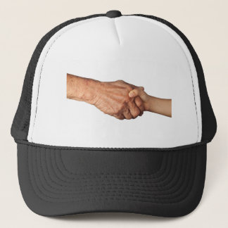 Handshake between a senior and a child trucker hat