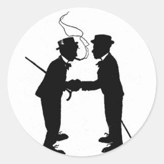 Handshake between gentlemen classic round sticker