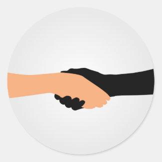 Handshake- Graphic to portray- Stop racism Classic Round Sticker