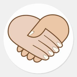 Handshake heart handshake heart classic round sticker