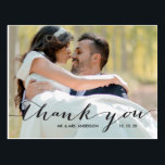 "Handwriting Black 2 Photo Wedding Thank You Postcard<br><div class=""desc"">Place two photos on your wedding thank you cards, one on the front and a second photo on the back. Send out your wedding thank you message as newly weds to your friends and family using this beautifully, simple thank you wedding photo postcard with the words &quot;thank you&quot; written in...</div>"