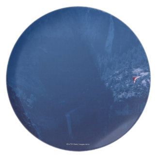 Hang Glider above Mountains Dinner Plate