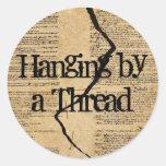 Hanging by a Thread Round Sticker