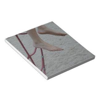 hanging foot climbing frame feet playground sand notepad