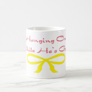 Hanging On While He's Gone Coffee Mug