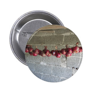 Hanging red onion collection button