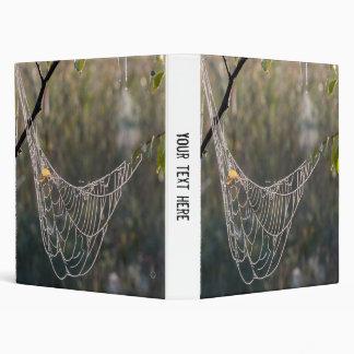 Hanging spiderwebs binder