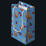 """Hanukkah Cat Dreidel Blue Gift Bag<br><div class=""""desc"""">Cat lovers will be delighted with this fun whimsical """"Hanukkat"""" pattern gift bag,  featuring a brown curious cat wearing a kippah,  red dreidels and yellow menorahs/channukiahs on a bright blue background. Perfect for wrapping your Hannukah / Chanukah gifts during the Jewish Festival of Lights!</div>"""