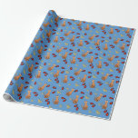 """Hanukkah Cat Dreidel Blue Wrapping Paper<br><div class=""""desc"""">Cat lovers will be delighted with this fun whimsical """"Hanukkat"""" pattern wrapping paper,  featuring an orange brown curious tabby cat wearing a kippah,  red dreidels and yellow menorahs/channukiahs on a bright blue background. Perfect for your Hannukah / Chanukah presents during the Jewish Festival of Lights!</div>"""