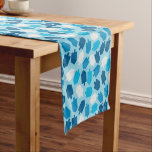 "Hanukkah Chanukah Driedel Pattern Short Table Runner<br><div class=""desc"">Celebrate the festival of lights with Hanukkah decorations from CBendel. From gift wrap to blankets, we offer a range of Hanukkah-themed decor. Our Hanukkah decorations and other items also make great gifts for family and friends. This festive table runner features a Driedel pattern in pretty shades of blue. You can...</div>"