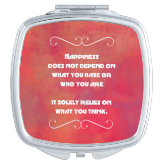 Happiness Quotation on an Orange Red Abstract Compact Mirror