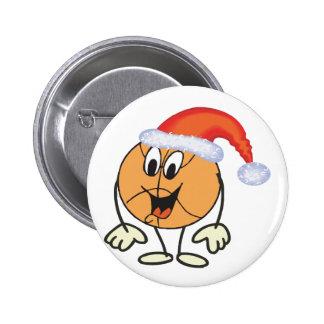 Happy basketball smiley wearing a santa hat pinback button