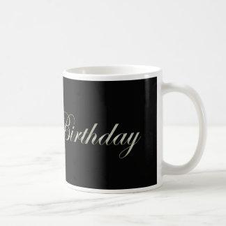 happy birthday in fancy letters on black coffee mug