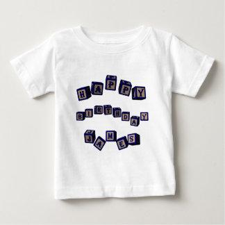 Happy Birthday James toy blocks in blue. Baby T-Shirt