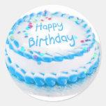 Happy birthday with blue frosting classic round sticker