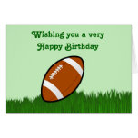 Happy Birthday with football on grass Greeting Cards