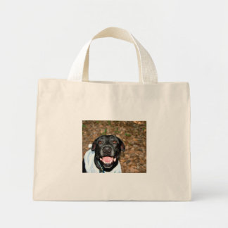 Happy black lab mix dog with fall leaves backgroun mini tote bag