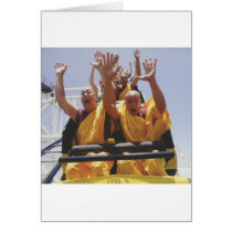 Happy buddhist monks on a roller coaster