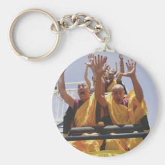 Happy buddhist monks on a roller coaster keychain