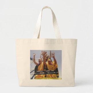 Happy buddhist monks on a roller coaster large tote bag