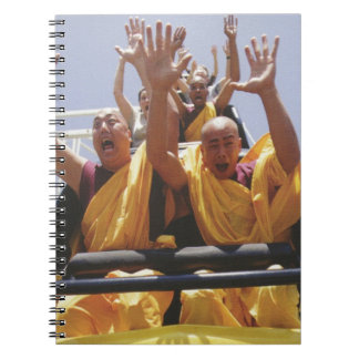 Happy buddhist monks on a roller coaster spiral note books