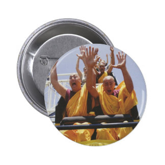Happy buddhist monks on a roller coaster pinback button