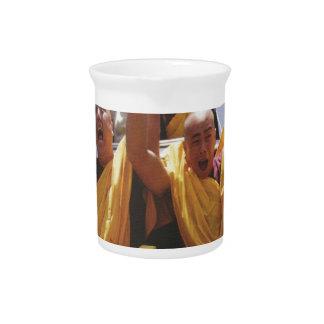 Happy buddhist monks on a roller coaster beverage pitcher