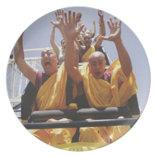 Happy buddhist monks on a roller coaster dinner plates