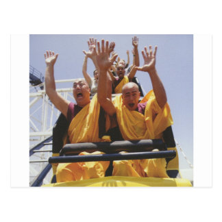 Happy buddhist monks on a roller coaster post card