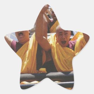 Happy buddhist monks on a roller coaster star sticker