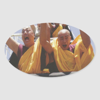 Happy buddhist monks on a roller coaster oval sticker