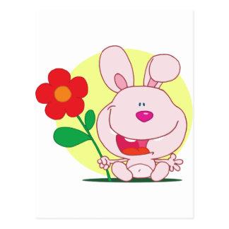 Happy bunny holds flower postcard